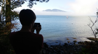 After a day in North Cascades, we spent the night outside a cool little island town, Anacortes, WA. The next morning, we got up and went to a park on the edge of the town and saw some of the most spectacular views of our trip. Here's Luke getting all Ansel Adams on us.
